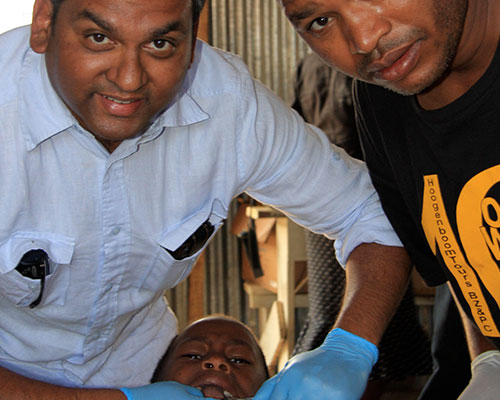 Dentist and man helping patient
